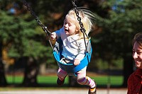 a young girl in a swing