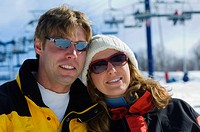 Couple on ski hill