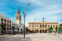 ecija, sevilla, spain, la plaza de espa±a with the town hall and the tower of the iglesia de santa maria in background