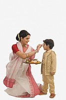 Woman celebrating Durga Puja with her son