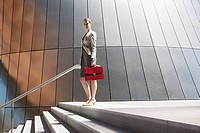 Businesswoman standing at top of steps outdoors