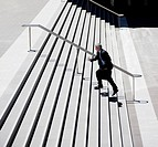 Businessman rushing up steps outdoors