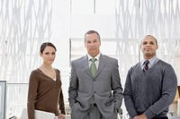 Business people standing in modern office
