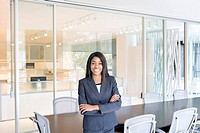 Smiling businesswoman standing in office conference room