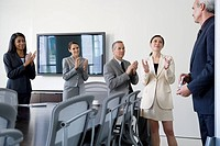 Business people clapping in conference room