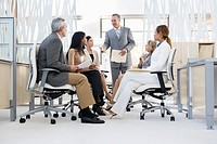Business people having meeting in middle of office