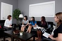 a group of women having a bible study