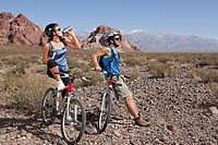 Mountain biker couple taking a break (thumbnail)