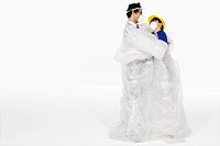 Couple hugging wrapped in bubble wrap