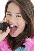 Caucasian children singing karaoke on a white background