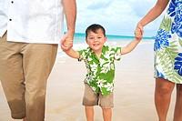 Hawaii, Oahu, Lanikai, Young Family strolling along the beach.
