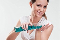 Woman pouring bath beads on her palm