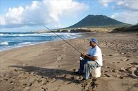 Sint Eustatius, man fishing off Zeelandia beach