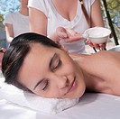 Woman receiving back message from a massage therapist