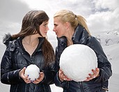 Teen girls challenge with snowballs