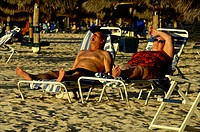 Aruba, elderly couple on Palm beaach