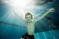 Underwater portrait of young boy age 8