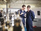 Engineer Teaching Male Apprentice