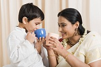 Woman with her son having coffee