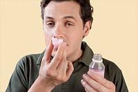 Man smelling medicine syrup