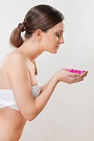 Woman smelling bath beads