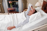 Man lying in a hospital bed