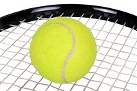 Close_up of a tennis racket with a tennis ball