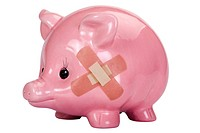Close_up of a piggy bank with an adhesive bandage