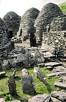 Ancient Celtic monastic settlement at top of island of Skellig Michael, County Kerry, Ireland  Stone huts and graveyard crosses