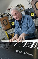 Rick Lloyd, former member of the British 80's band the Flying Pickets playing keyboard in his home studio in Cwm Ystwyth village near Aberystwyth, Wal...
