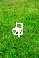 White chair in field, Hayama town, Kanagawa prefecture, Japan