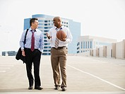 Businessman on their way to basketball game