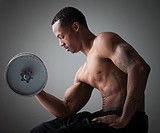 Muscular man lifting a dumbbell