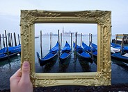Grand Canal and gondolas at dawn framed within ornate picture frame in Venice Italy