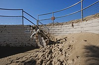 Beach sand spills down stairs from beach area, Ventura, California, USA