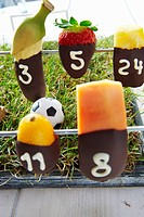 Table football with chocolate_dipped fruit