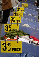 Used clothing on sale at Saturday market in Pezenas, France