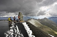 Cyclists at the Cime de la Bonette the summit of the alps Col de la Bonette, Alpes Maritimes, in summer, France