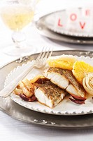 Fish with fennel, orange slices and olives