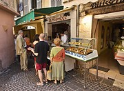 Queue at a street delicatessen store in old quarter of Vence Cote D Azur France Europe