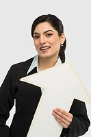 Businesswoman holding an upward arrow sign