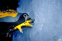 Man, gets the point with his crampon while ice climbing in the Snake River Canyon near the city of Twin Falls, Idaho