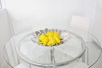 Bowl of artificial pears on a dining table
