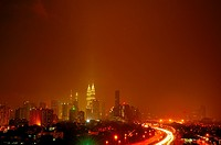 Cityscape at night with Petronas Towers in the background, Kuala Lumpur, Malaysia