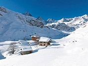 Huts in a snow covered valley, Alpine Village, Piedmont, Italy