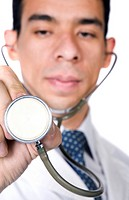 male doctor over a white background with a stethoscope