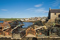 St Margarets Hope SOUTH RONALDSAY ORKNEY Lobster creels waterfront quayside harbour houses town