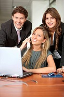 Small team of business people in an office smiling