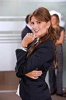 Beautiful business woman in an office smiling