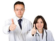 couple of doctors with a positive attitude _ thumbs up over a white background _ focus is on the faces